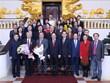 Le vice-PM et ministre des AE Pham Binh Minh reçoit des délégués du Forum populaire Vietnam-Chine