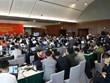 Des centaines de journalistes travaillent pour couvrir la séance d'ouverture du 13e Congrès du Parti