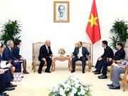 Le PM Nguyen Xuan Phuc reçoit un conseiller du Premier ministre japonais