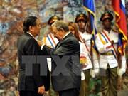 Le président du Laos reçoit l'Ordre José Marti de Cuba