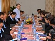 Echange professionnel entre journalistes vietnamiens et laotiens