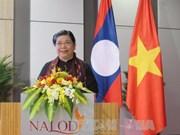 Echanges professionnels entre les deux bureaux de l'AN du Vietnam et du Laos