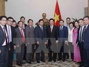 Le vice-PM Pham Binh Minh reçoit la délégation de l'Union de la jeunsse du Laos