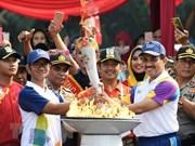 La flamme des ASIAD 2018 arrive à Jakarta pour la cérémonie d'ouverture