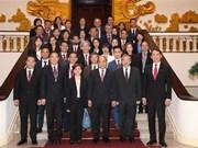 Le PM reçoit des hommes d'affaires singapouriens