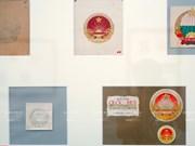 Le processus de création de l'emblème national du Vietnam s'expose à Hanoi