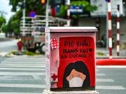 Hanoï : des coffrets électriques portant des messages de lutte anti-COVID-19