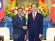 Le président Trân Dai Quang reçoit le chef du bureau présidentiel laotien