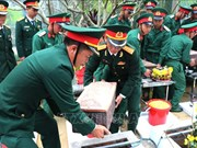 Inhumation des restes des martyrs à Ha Giang et Gia Lai
