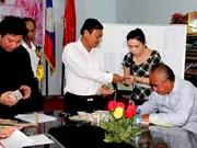 Laos : soutien des commerçants du marché Thongkhankham