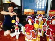 Une artisane des jouets pour la Fête de la mi-automne
