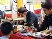 Calligraphies et chant alterné au Temple de la Littérature
