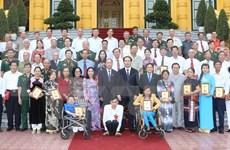 Le président Tran Dai Quang rencontre des victimes de l'agent orange/dioxine