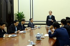 Tran Dai Quang travaille avec des responsables du Conseil consultatif des entreprises de l'APEC