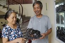 La sculpture sur charbon tout feu tout femme à Ha Long