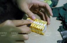 La fabrication de feuilles d'or du village de Kiêu Ky