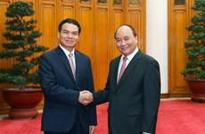 Nguyên Xuân Phuc reçoit le président du Bureau du gouvernement laotien