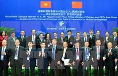 Le Premier ministre dialogue avec des hommes d'affaires chinois