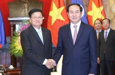 Le président Tran Dai Quang reçoit le Premier ministre laotien Thongloun Sisoulith