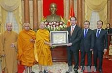 Le président Tran Dai Quang reçoit la délégation d'une secte bouddhique vietnamienne en Thaïlande
