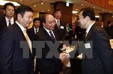 Le PM Nguyen Xuan Phuc au colloque avec les entreprises des TI du Japon