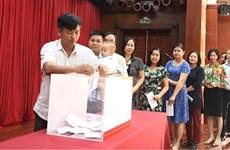 La communauté vietnamienne au Laos en aide aux sinistrés des crues