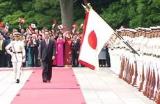 La cérémonie d'accueil du président Tran Dai Quang vue par les médias japonais