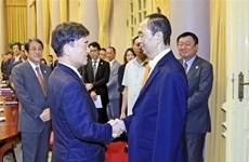 Le président Tran Dai Quang reçoit le conseiller spécial du groupe japonais Mainichi