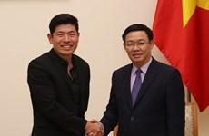 Le vice-PM Vuong Dinh Huê reçoit le directeur exécutif de Grab Anthony Tan