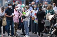 COVID-19: Les visiteurs étrangers confiants en les mesures prises par Hanoi