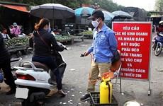 Ce week-end, des tests rapides de dépistage de virus SARS-CoV-2 aux marchés de vente en gros à Hanoï