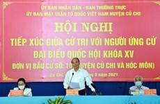 Le président Nguyen Xuan Phuc rencontre des électeurs de Ho Chi Minh-Ville