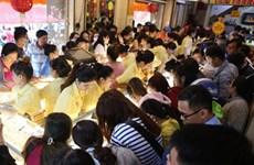 Des milliers de Vietnamiens fêtent le Dieu de la Richesse