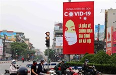 COVID-19 : la presse internationale salue l'efficacité du Vietnam