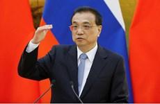 Le Premier ministre chinois appelle à la coopération et la solidarité pour lutter contre le Covid-19