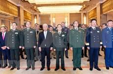 Commémoration du 75e anniversaire de la fondation de l'Armée populaire du Vietnam en Chine