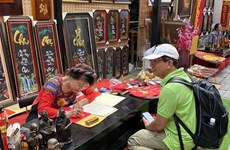 Marché de la calligraphie du Têt à Ho Chi Minh-Ville