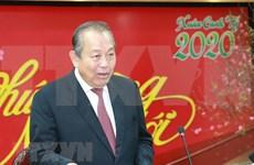 Le vice-PM Truong Hoa Binh rencontre la communauté vietnamienne en Suisse à l'occasion du Têt