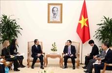 Le vice-PM Vuong Dinh Hue reçoit le président de la société japonaise de services financiers AEON