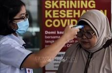 COVID-19 : de nombreux pays resserrent des mesures pour contenir la pandémie