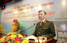 Cérémonie de célébration du 60e anniversaire de l'envoi d'experts de police vietnamienne au Laos
