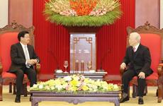 Le secrétaire général et président lao au Vietnam pour approfondir les liens