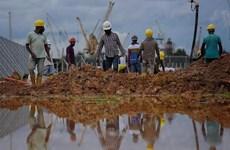 Singapour: 265.000 travailleurs étrangers peuvent reprendre leur travail