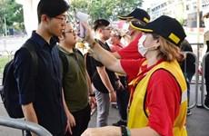 nCoV: Singapour lève son niveau d'alerte, le gouvernement thaïlandais vend des masques de protection