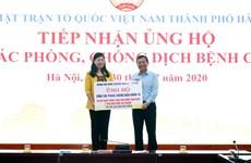 Hanoï reçoit des dons pour lutter contre le COVID-19