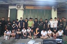 Vingt-et-un personnes recherchées par la police chinoise sont arrêtées à Lao Cai