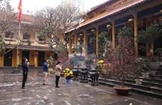 Têt: pagodes, labeur, rédemption