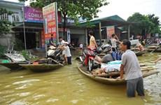 Débat sur les impacts des inondations du Vietnam à Paris