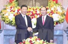 Entretien entre les présidents Tran Dai Quang et Xi Jinping