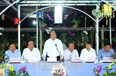 Le chef du gouvernement parle agriculture dans des halls d'assemblée des paysans